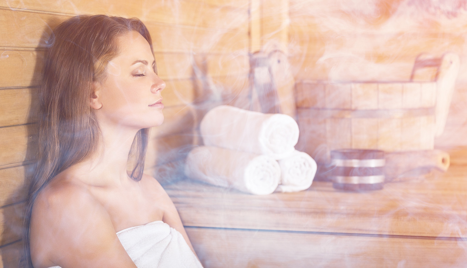 woman enjoying halotherapy salt room sauna