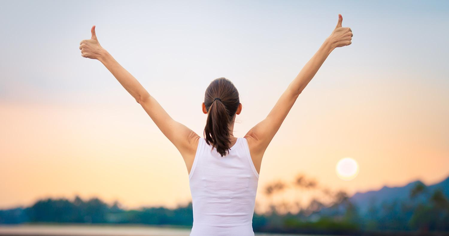 woman happy with wellness success